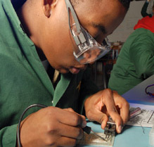 Electrical apprentice working on a job task